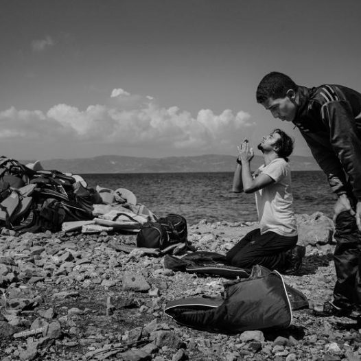Muslim men pray upon reaching the beach in Lesbos, Greece, September 25, 2015.   James Nachtwey for TIME