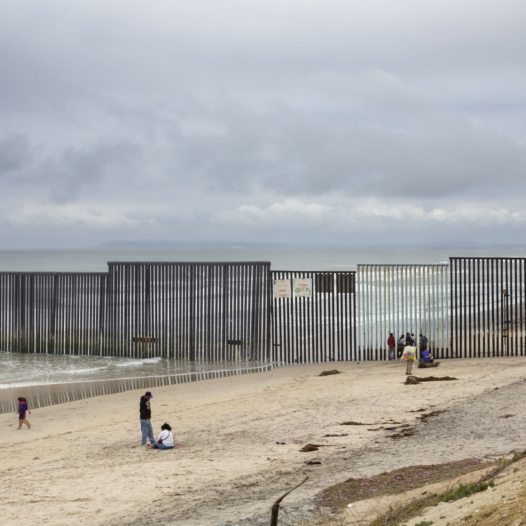 The border between Tijuana and San Diego is today a massive metal wall.It extends down to the beach stretching out some three undred feet into the Pacific Ocean
