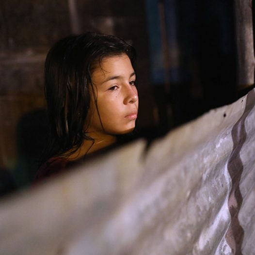 SAN PEDRO SULA, HONDURAS - AUGUST 18:  A girl looks from the modest yard of her family's one-room home in an impoverished neighborhood on August 18, 2017 in San Pedro Sula, Honduras. Honduras, consistently ranked as one of the poorest nations in the Western Hemisphere, also has one of the highest murder rates in the world. The poverty and violence have driven immigration to the U.S., although the number of U.S.-bound immigrants has dropped greatly during the first months of the Trump Presidency.  (Photo by John Moore/Getty Images)