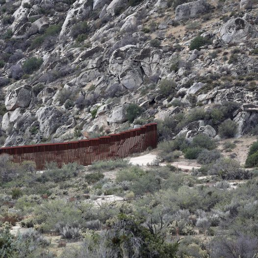 JACAMBA HOT SPRINGS, CA - SEPTEMBER 26:  The border fence stops at a hillside on the U.S.-Mexico border fence on September 26, 2016 in Jacamba Hot Springs, California. The border stretches almost 2,000 miles, much of remote areas, and fencing often stops due to geographical featues, such as hills and rivers.  (Photo by John Moore/Getty Images)